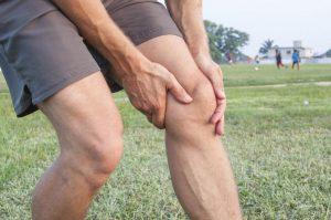 Боль в колене и судороги